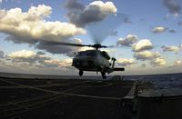 A SH-60 Seahawk of HSL-51, Detachment 6 lands on the flightdeck during flight ops. The SH-60 Seahawk performs Sonar and Search And Rescue (SAR) missions while onboard. Currently the USS Vincennes (CG-49) is operating in the Sea of Japan. - 2000