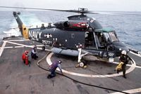 A Light Helicopter Anti-submarine Squadron 32 (HSL-32) SH-2F Seasprite helicopter is refueled on the helicopter deck of the guided missile cruiser USS WAINWRIGHT (CG-28). - 1988