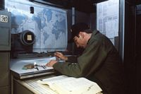 A sailor plots a course in the charthouse aboard the guided missile cruiser USS WAINWRIGHT (CG 28). - 1988