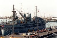 The destroyer tender USS YOSEMITE (AD-19) stands in port. The vessel is in the region in support of maritime interdiction operations.<br>- 1991