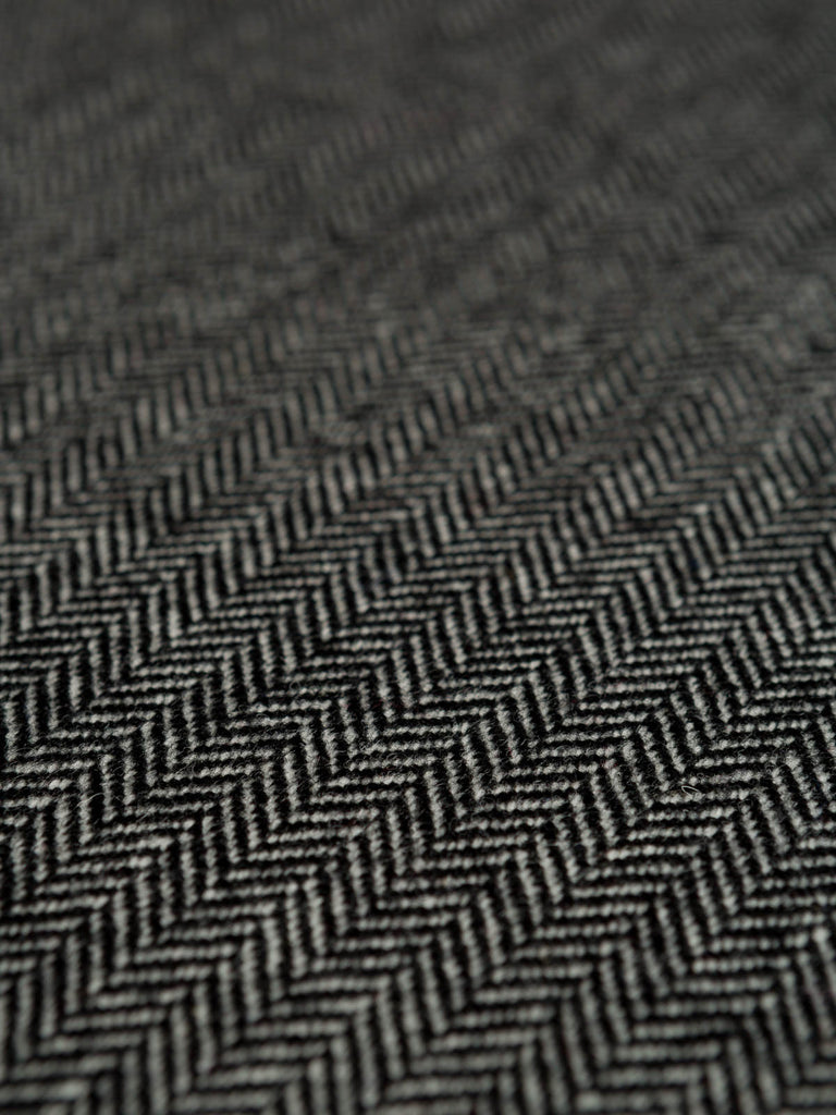 The smokey grey tones that weave their way through this 100% wool Herringbone weave echo memories of the industrial Yorkshire landscape and its mill heritage.