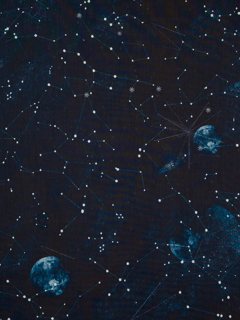 Lightweight 100% cotton shirting fabric. Constellations design in navy, denim blue and white tones