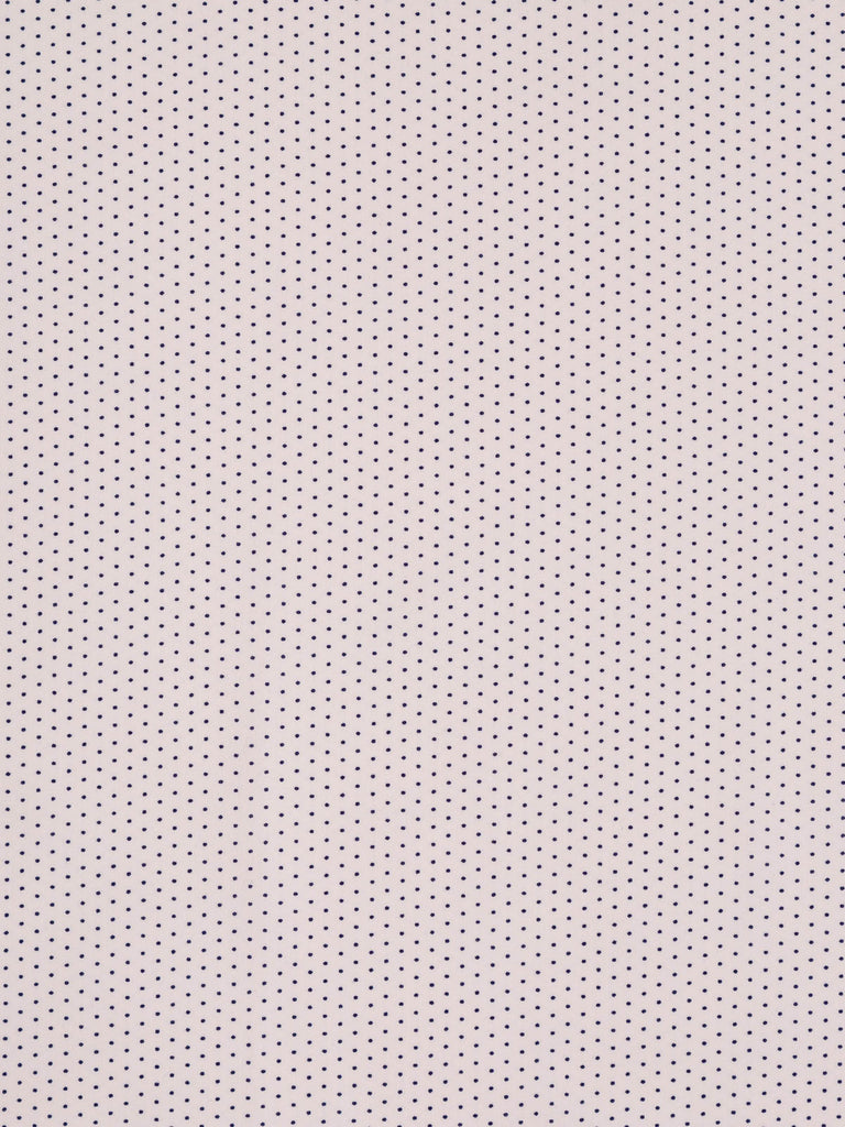 Lightweight cotton lawn fabric. Baby pink background with small navy polka dots