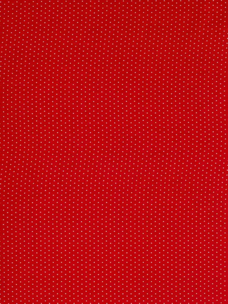 Lightweight 100% fine cotton lawn. Red background with tiny white polka dots
