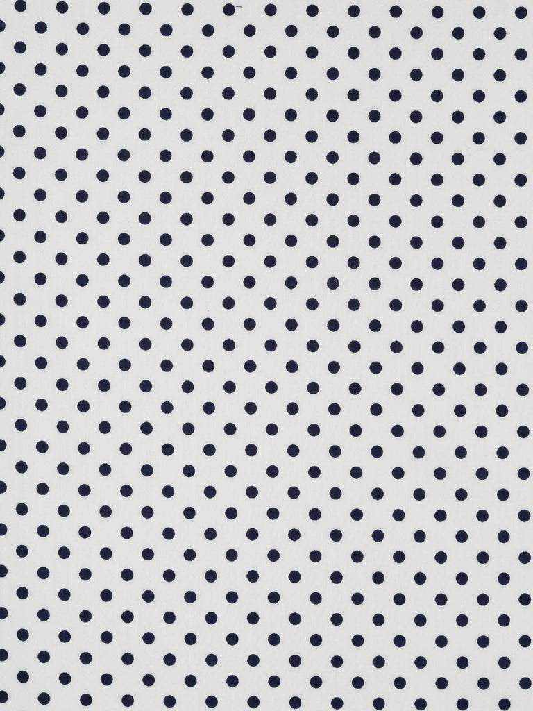 Lightweight cotton lawn fabric. Natural white background with robust navy polka dot pattern
