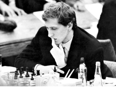 bobby fischer life posing with chess board