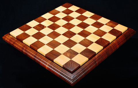 a wooden chess board on black background