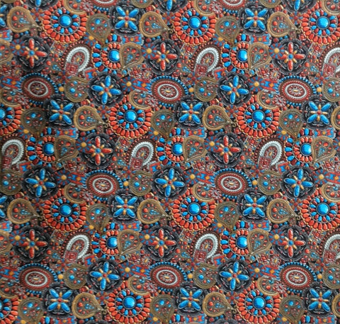This 100% Cotton Bandana with the print of vibrant turquoise and orange conchos on it.  other colors add details that make the conchos pop out .  Wonderful accessory to wear with any outfit.