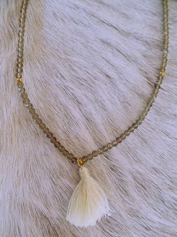 "Embellish Maison 21"" Crystal Stretch Necklace With Cotton Tassel"