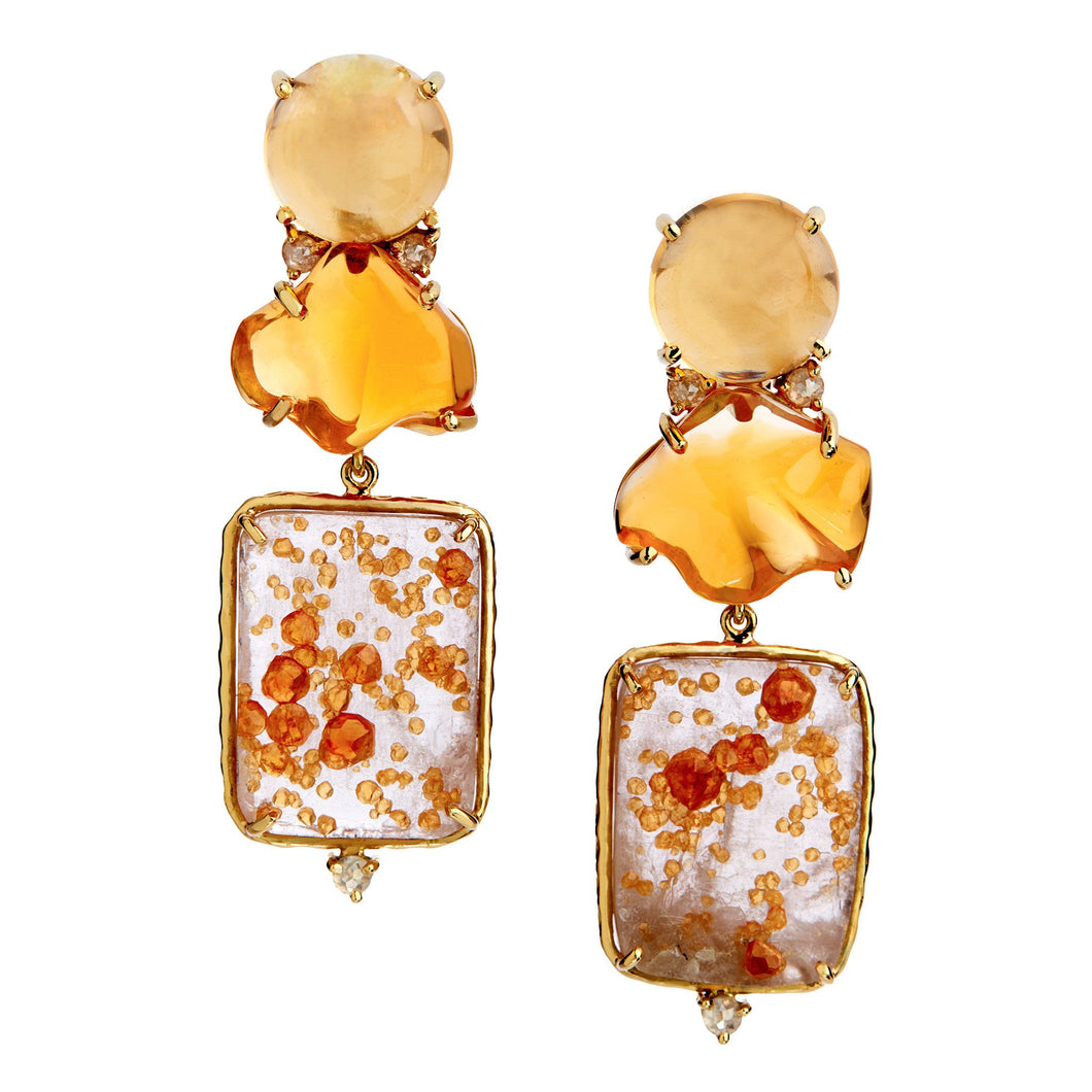 specimens of spessartite garnet with citrine, free-form mexican opal, and rose-cut pale yellow diamonds.
