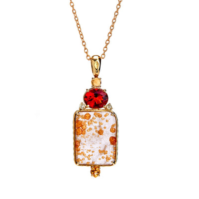 specimen of spessartite garnet, citrines, maderia citrine, and rose-cut pale yellow diamonds