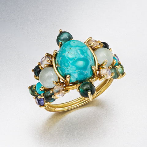 Cripple Creek turquoise with aquamarine, tourmaline, iolite in 18k yellow gold.