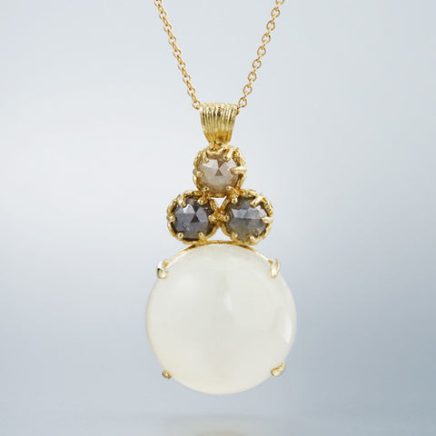 White Moonstone in 18k yellow gold with grey rustic diamonds