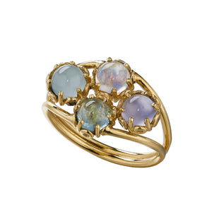 ethereal blues of aquamarine, rainbow moonstone, chalcedony and tourmaline make up this 18k yellow gold ring