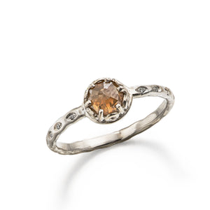platinum engagement ring with rose cut brown diamond