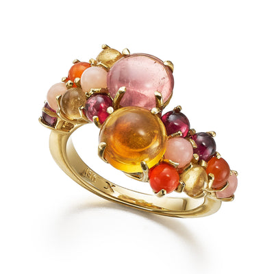 Stacking cluster ring with pink tourmaline and citrine and a medley of cabochon gemstones