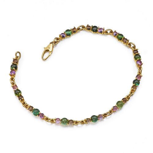modern tennis bracelet with cabochon cut tourmaline, amethyst and smokey citrine
