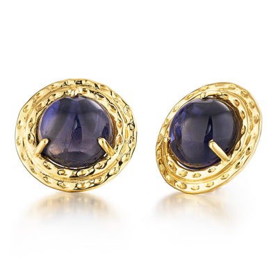 large cabochon navy iolite gemstone centers a double surround of 18k yellow gold