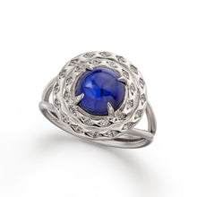 blue sapphire cabochon surrounded by a halo of diamond set engraved 18k white gold