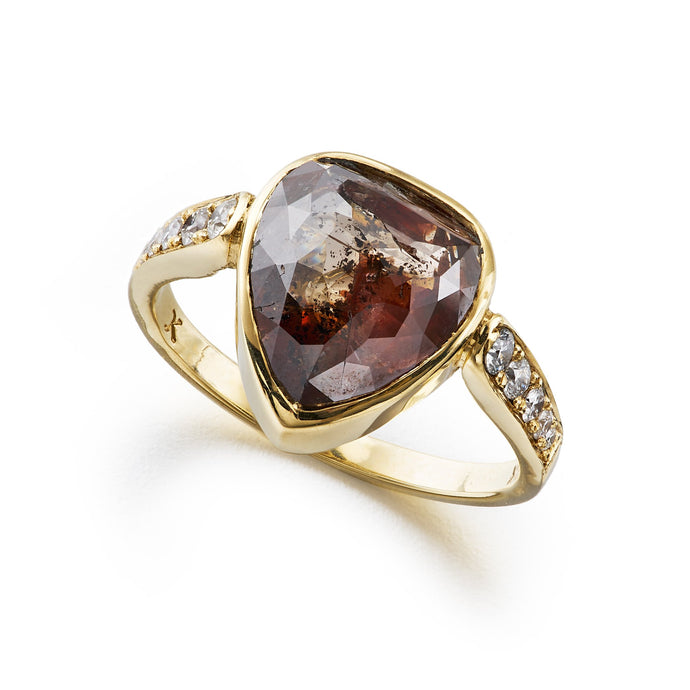 chocolate brown, pear-shaped rose cut diamond ring with white diamond pavé sides in yellow gold