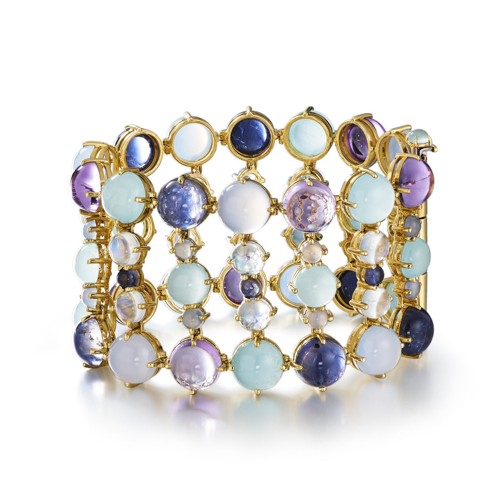 two inch wide flexible bracelet with perfectly matched aquamarine, chalcedony, amethyst and iolite set in 18k yellow gold