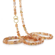extra long necklace of shimmering iron quartz and diamonds set beads of 18k yellow gold
