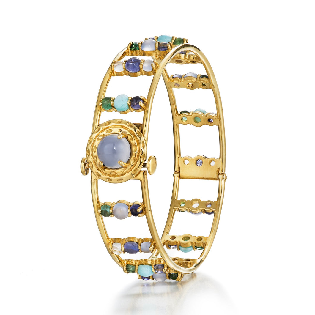Everyday bangle with a medley of blue and green gemstones