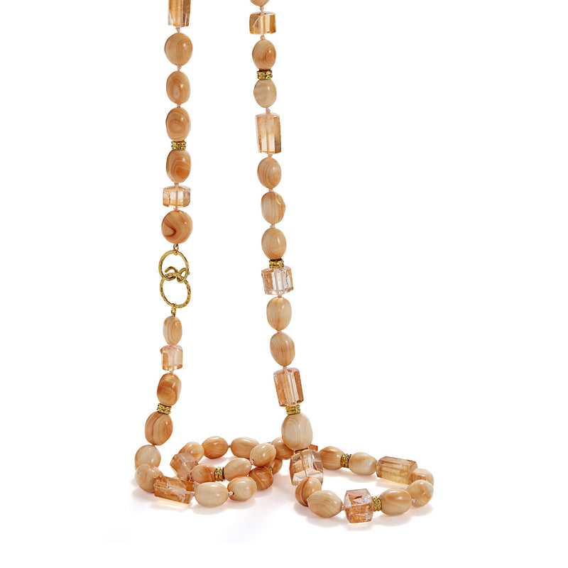 necklace with nugget-shaped King conch beads, iron quartz, diamond-studded rondel