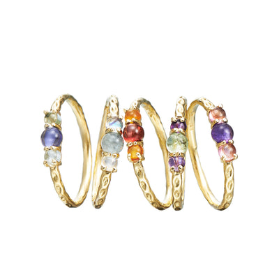 dainty stacking cabochon gemstone rings in 18k yellow gold