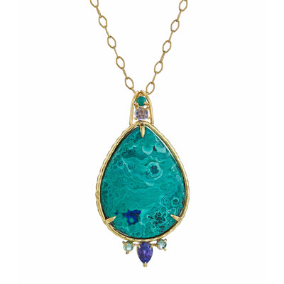 pear-shaped azurite-malachite, turquoise, rose-cut iolite, faceted tanzanite, tourmalines. Set in 18k yellow gold