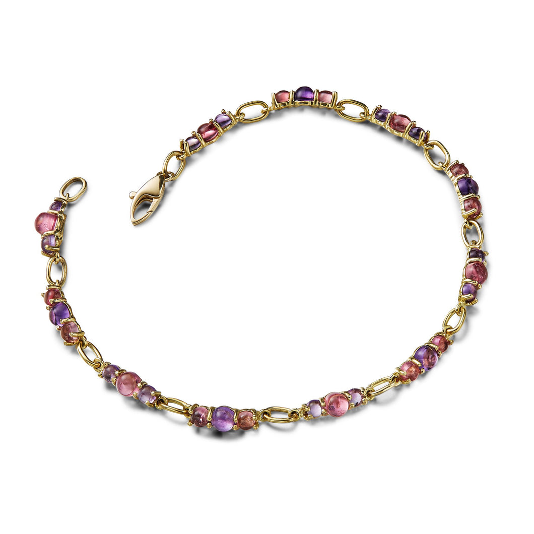 Cabochon gemstone tennis bracelet with amethyst, iolite and pink tourmaline, 18k yellow gold