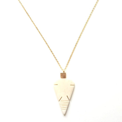 Image of Arrowhead Bone Pendant on a Long Gold Chain