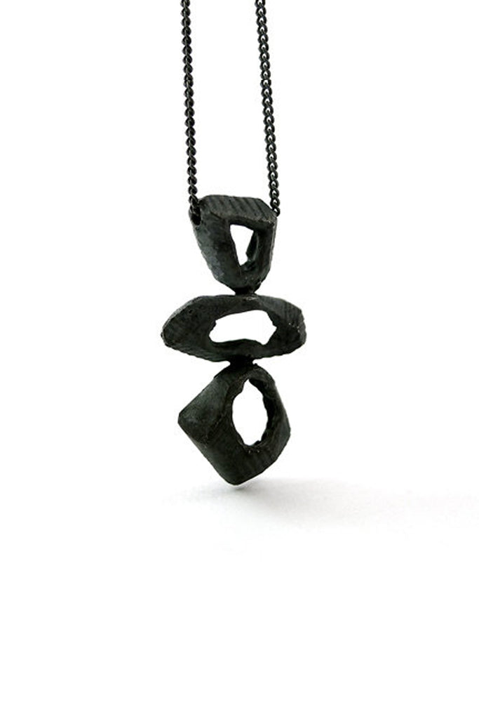 black contemporary celtic raw rock pendant necklace from sterling silver  by lacuna jewelry