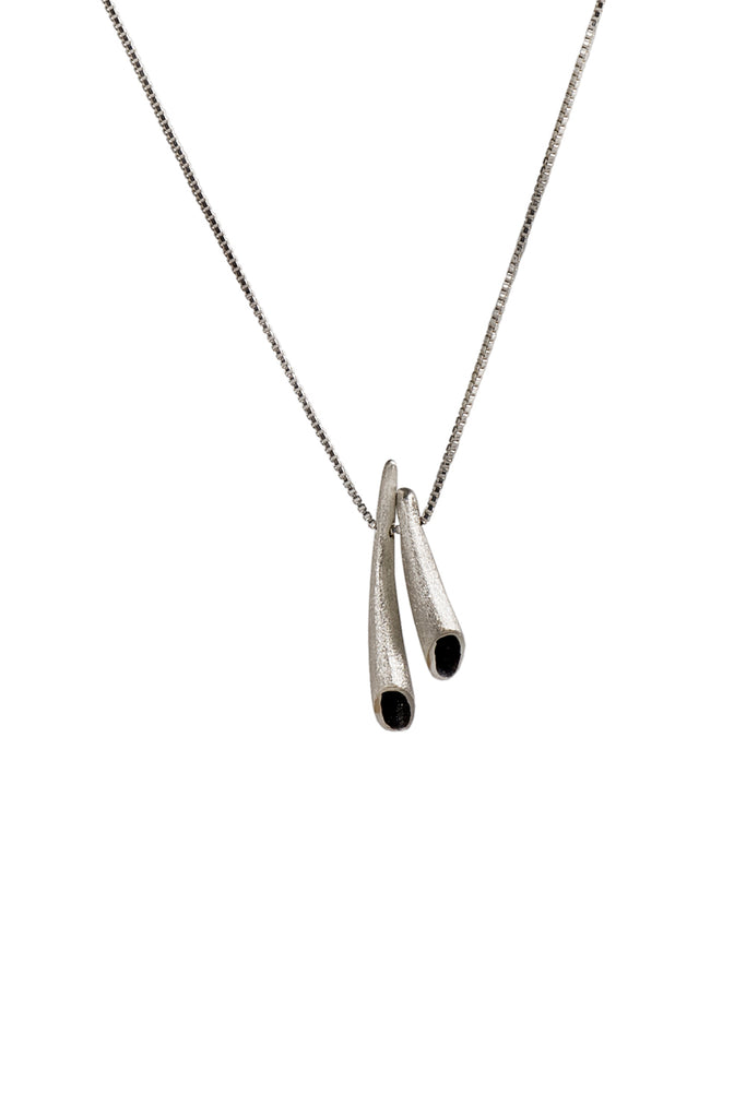 dainty silver charm pendant necklace by lacuna jewelry