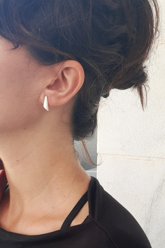 Minimalist simple dainty Silver stud earrings by lacuna jewelry