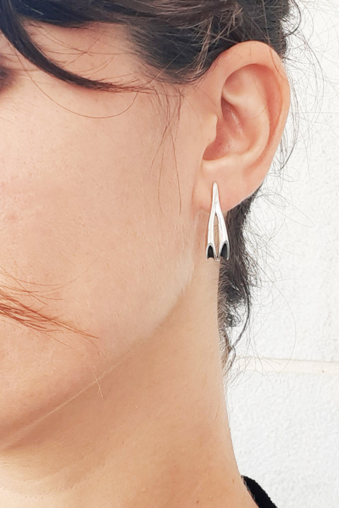 Modern long Silver stud earrings by lacuna jewelry