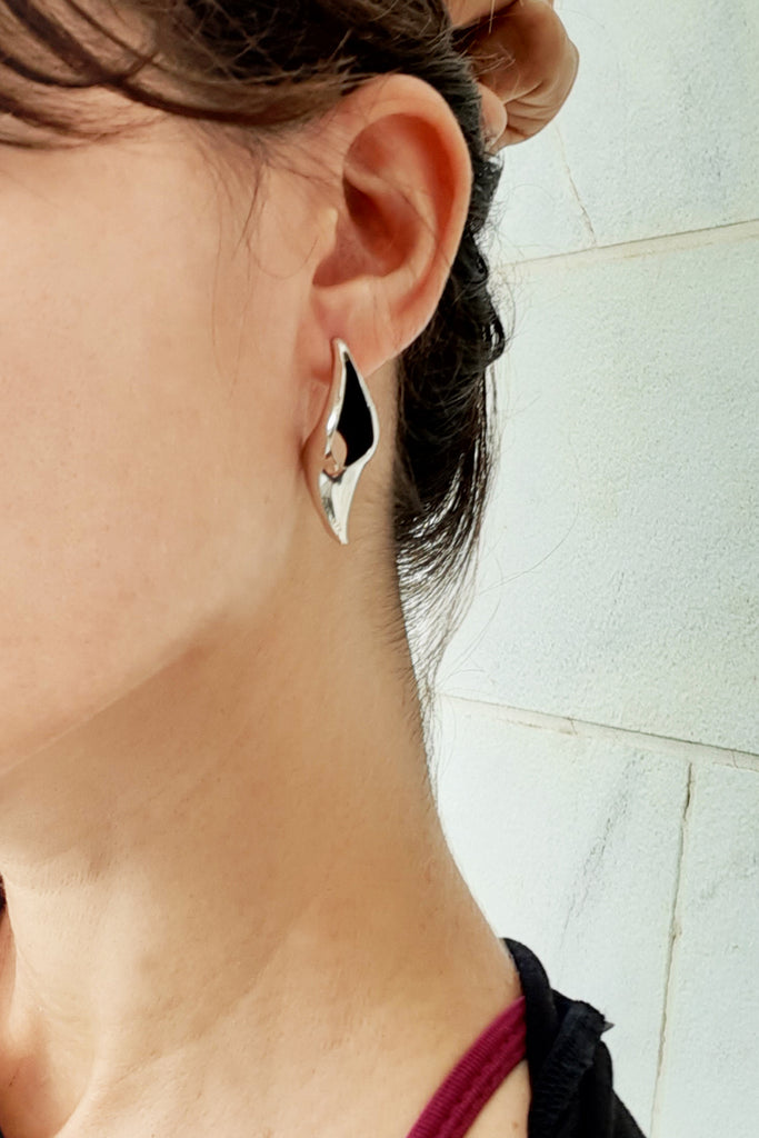 contemporary chunky statement stud earrings made of sterling silver by lacuna jewelry