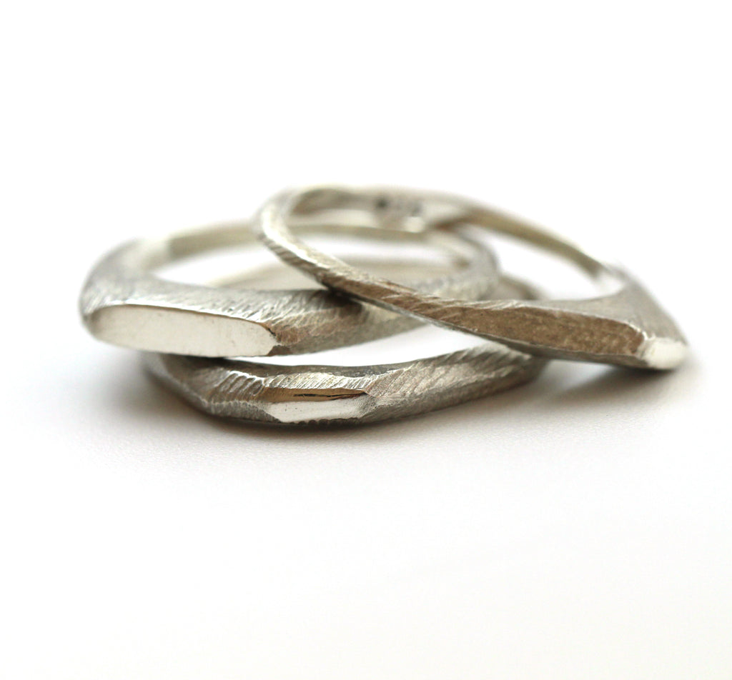 Three dainty stacking rings made from Sterling Silver\ by lacuna jewelry