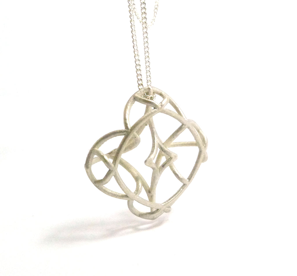 dainty romantic silver necklace by lacuna jewelry
