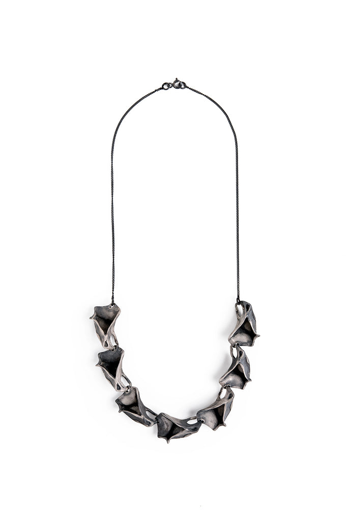 unique contemporary handmade statement necklace made of oxidized sterling silver inspired by nature ocean  made by lacuna jewelry