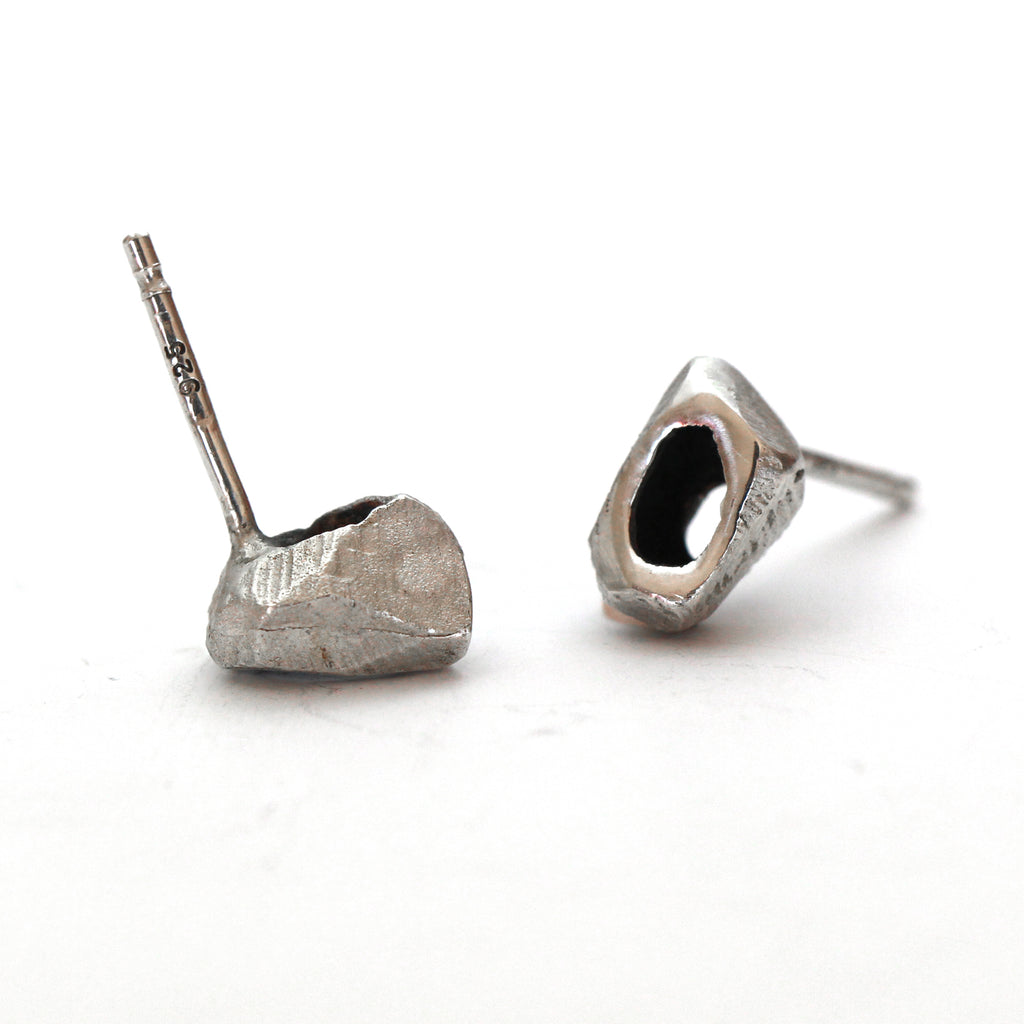 Unique tiny Silver stud earrings by lacuna jewelry