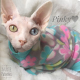 odd eye sphynx cat in long sleeve Nudie Patooties Fleece shirt.