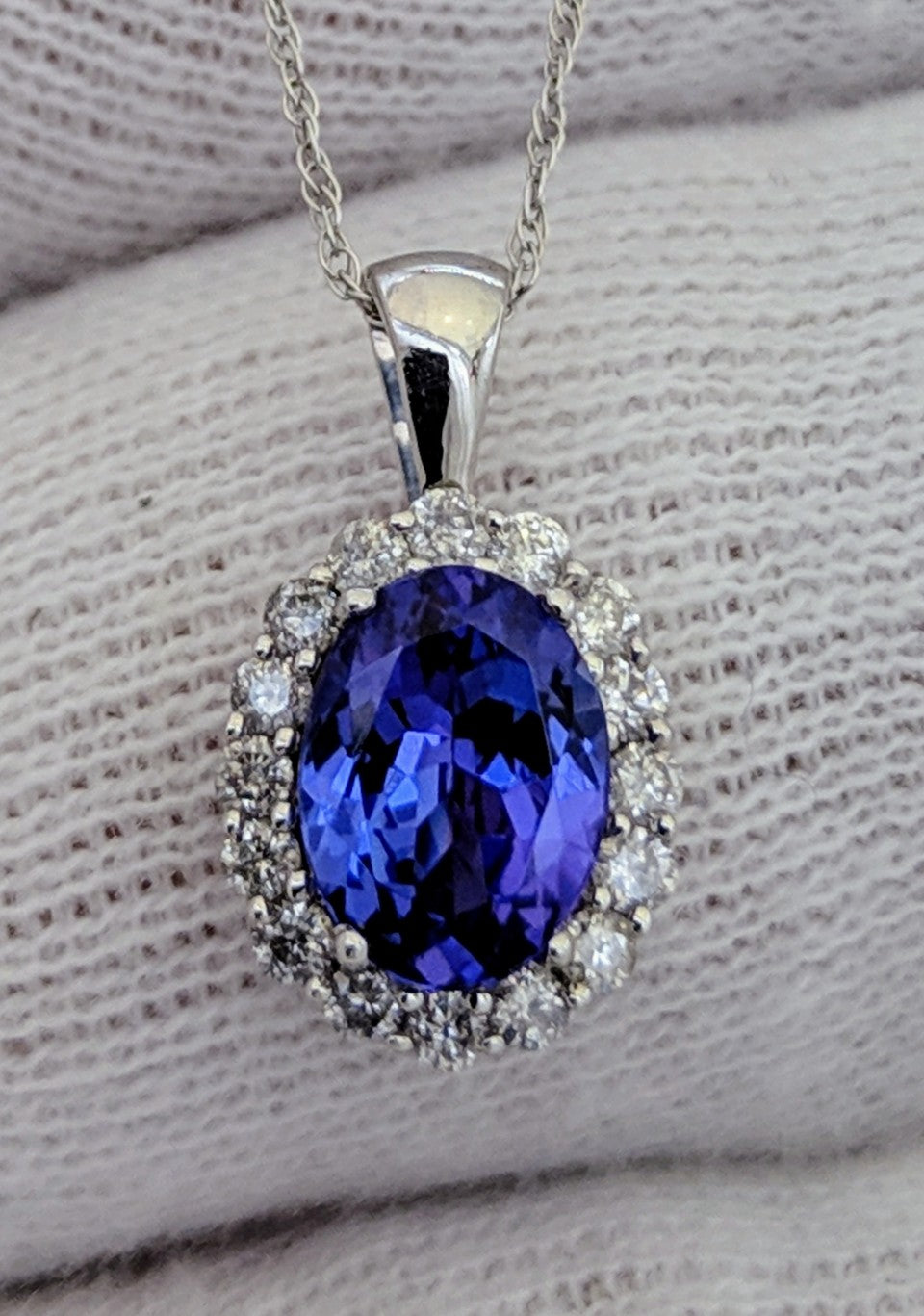 Tanzanite & Diamond Halo Pendant 14kt White Gold