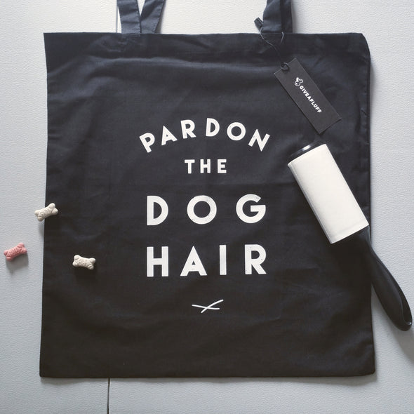 Pardon the Dog Hair black tote bag.