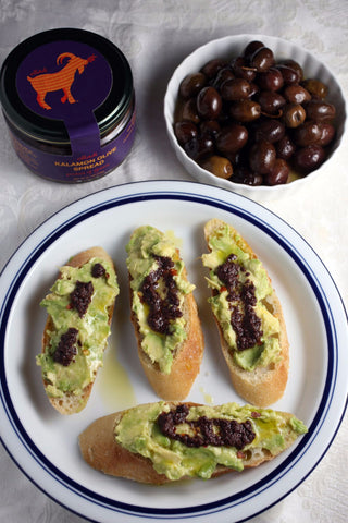 Oilladi Kalamon olive spread, avocado on bread with olives