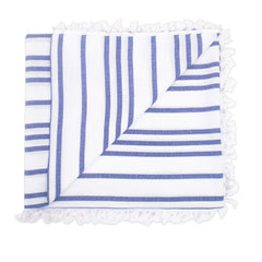 Beach blanket with blue stripes and tassels