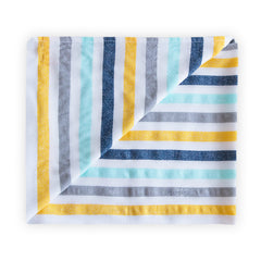 Yellow white green beach blanket with stripes above