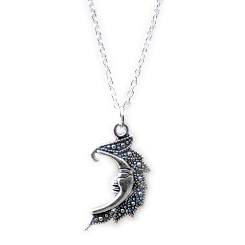 FLYNN. Silver Tone Ornate Moon Necklace | Elnique