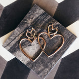 YSABEL. Rose Gold Double Heart Hoop Earrings - ELNIQUE | Shop a treasure trove of boho jewellery, accessories and clothing