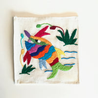 Set of 6 coasters, hand embroidered from Mexico.